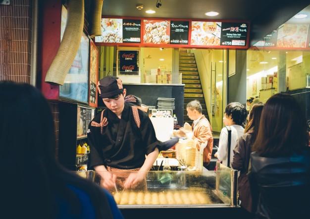 osaka-japan-september-1-unidentified-chefs-prepare-takoyaki_1258-87